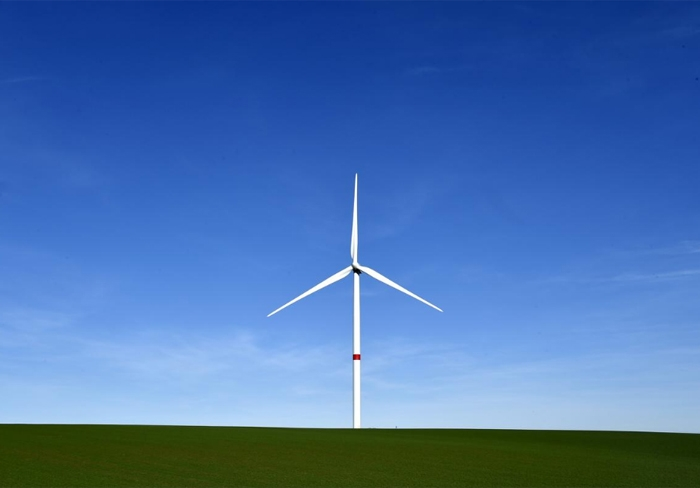 A-wind-turbine-stands-still-in-a-field-in-Waremme,-Belgium,-January-25,-2016.jpg