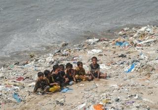 Plastic waste on the beach at Versova Creek, Mumbai, India