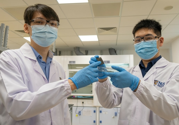 Assistant Professor Benjamin Tee (left) and doctoral student Guo Hongchen hold up a piece of AiFoam. Photo: National University of Singapore