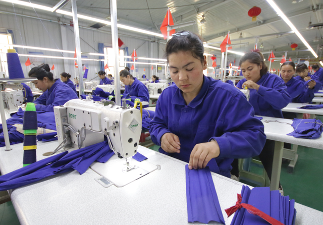 Uyghur women working in a textiles factory. Credit: Azamat Imanaliev / Shutterstock