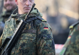 German soldiers, armed with Heckler & Koch G36 5.56×45mm NATO assault rifle, taking part at the Romanian National Day military parade. Photo: M.Moira / Shutterstock