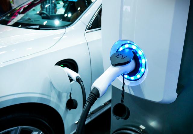 Electric vehicle charging. Credit: buffaloboy / Shutterstock