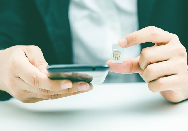 Sim and phone. Photo: Justyle/Shutterstock